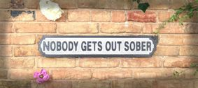 Wooden sign: Nobody Gets Out Sober.