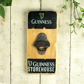 Wooden sign with bottle opener. Guinness.