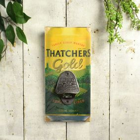 Wooden sign with bottle opener. Thatchers