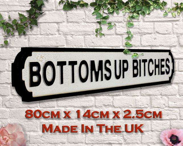 Wooden sign: Bottoms up bitches