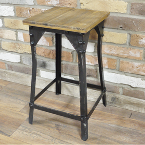 Industrial style metal angle stool.