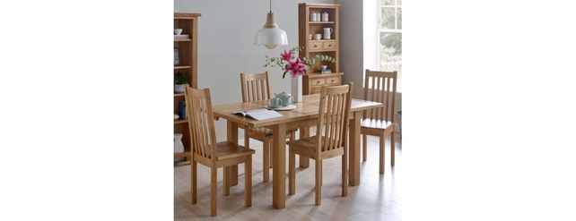 Venice range: Extending dining table with four wooden chairs.