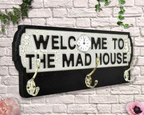 Wooden sign: Welcome To The Mad House Antique Style