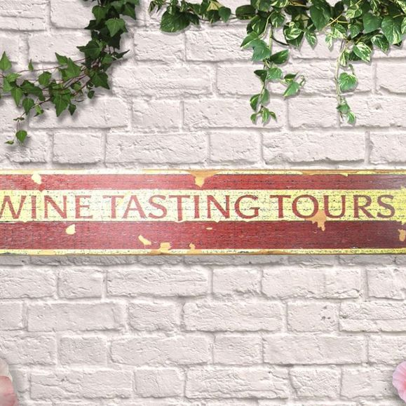 Distressed wooden sign.Wine tasting.