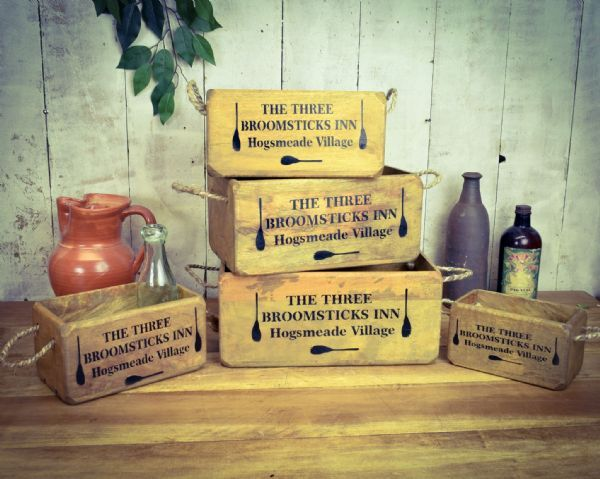 Three broomsticks hardwood boxes.