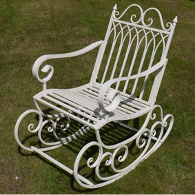 Antique white garden rocking chair.
