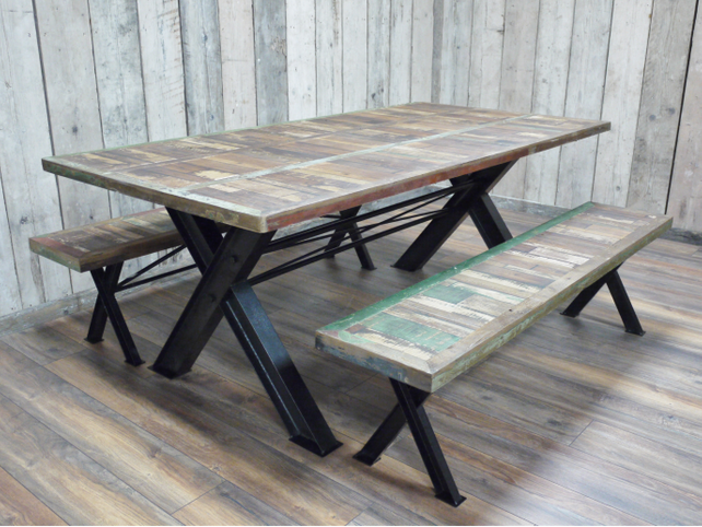 Loft style dining table with two matching benches.