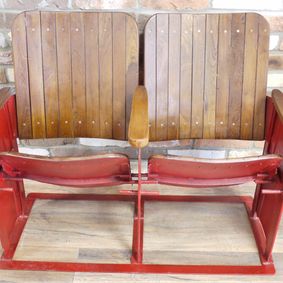 Reclaimed twin movie seat.