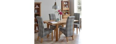 Venice range: Extending dining table with four tartan chairs.